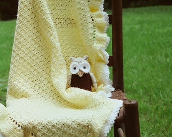yellow and white ruffled baby afghan