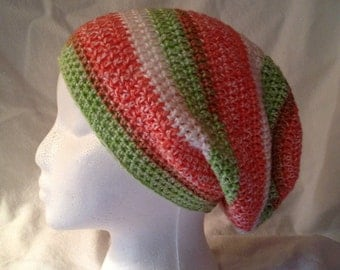Slouchy hat in shades of sherbet orange and green