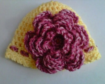 Crocheted newborn flowered beanie in yellow