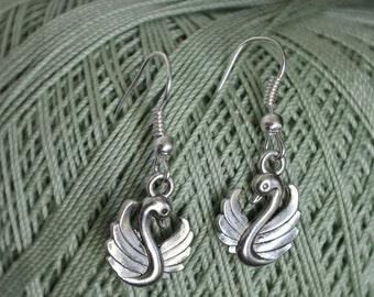 Swan lake inspired earrings in silver tone