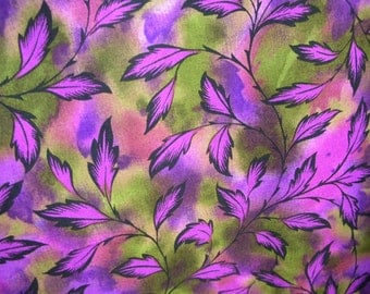 Fushia, purple and green all over leaf patterned fabric