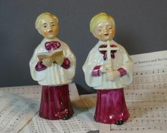 Pair of porcelain choir boys