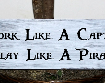 Work like a captain play like a pirate wood sign