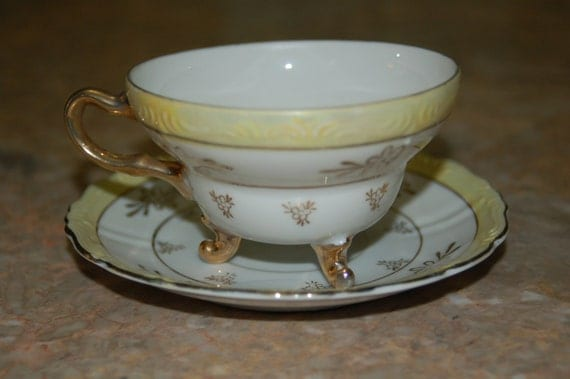 Vintage Porcelain Yellow and white Tea Cup and Saucer