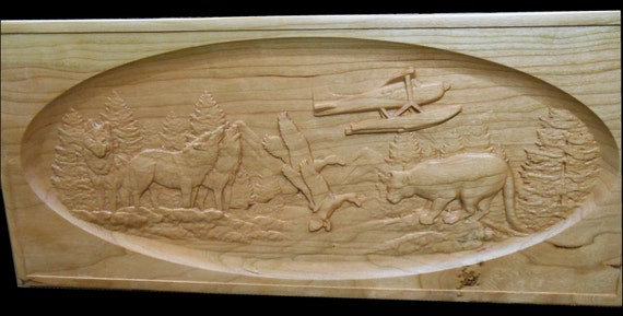 Relief wood carving flying over wildlife