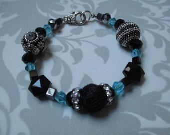Chunky black and aqua beaded bracelet