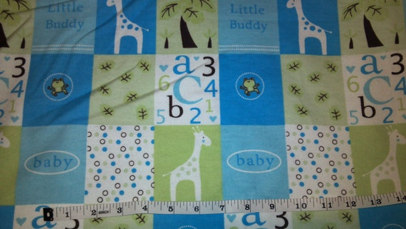 Blue Baby Boy And Giraffe Flannel Fabric Bty