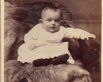 Antique Photo of Baby Sitting on Furs