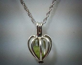 "Sterling silver keepsake pendant with 18"" ss chain."