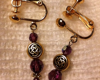 Amethyst and gold plated clip on earrings with Celtic beads.