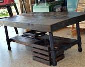 "40""x20""x17"" Industrial coffee table made from salvaged barnwood with steel pipe legs"