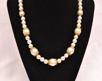 Pearl wedding necklace with gold accents