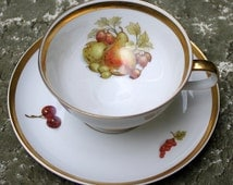 Porcelain teacup and saucer with painted fruit and golden rims.  Made in Bavaria by Royal Crown E&R.  Collectible cup and saucer.