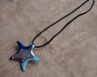Blue star pendant necklace. Silver gold and shades of blue star pendant necklace. Pendant jewerly on black cord. Star necklace jewelry.