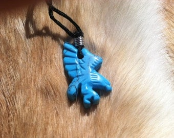 Carved stone eagle necklace.  Made of turquoise.