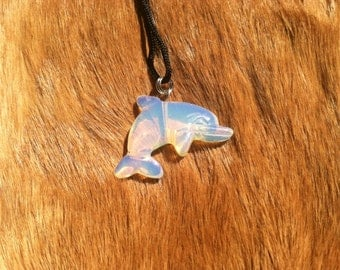 Carved stone dolphin necklace.  Made of moon stone.