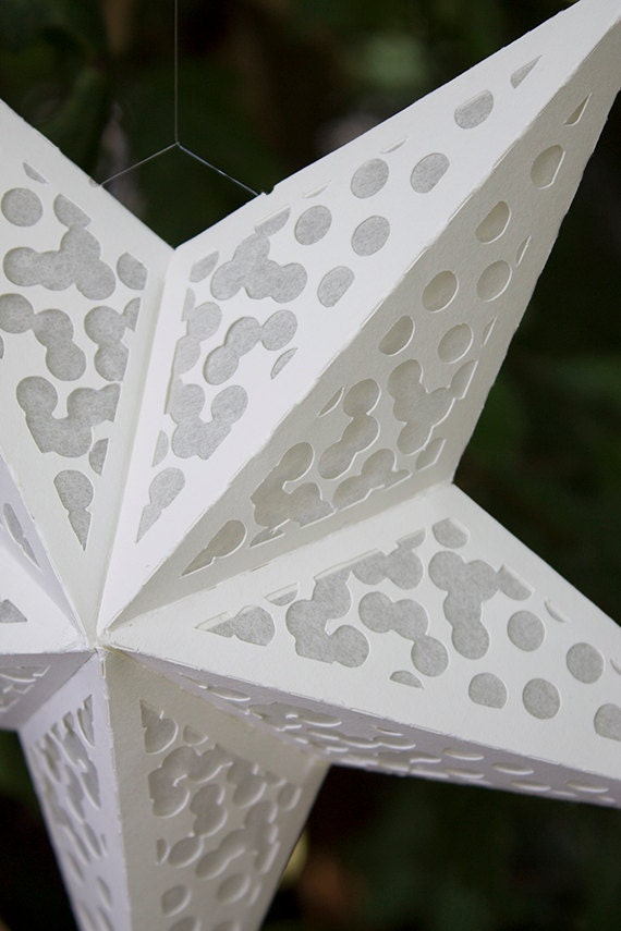 Paper star lantern with confetti cutouts by for Paper star cut out template