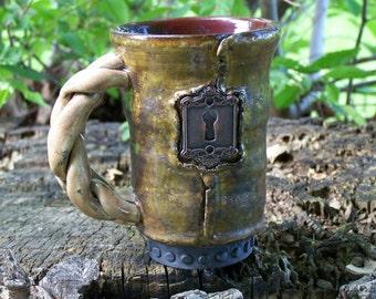hand made pottery mug, high fired raku