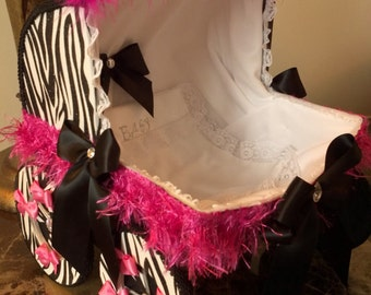 The Oslyn 14 Inch Black And Pink Zebra Baby Carriage Centerpiece With Personalized Blanket