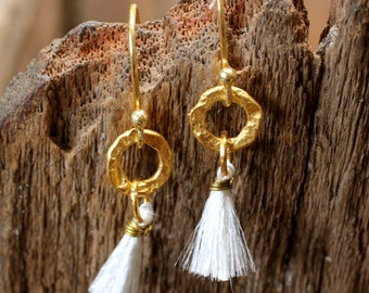 White cotton dangle earrings with hand textured brass hoop