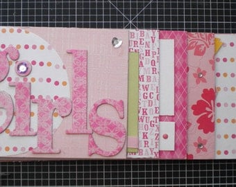 Darling Mini Scrapbook Album made for the girls in your life. Includes 13 pages