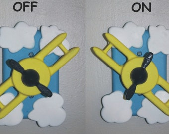 yellow airplane light switch cover with rotating airplane