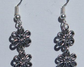 Beautiful blue butterfly and daisy dangle earrings
