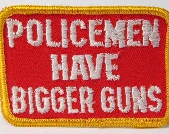 POLICEMEN Have BIGGER GUNS.  jacket or shirt patch.