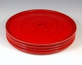 "Torch Red Dinner Plates. These handmade plates in Torch Red glaze will bring beauty to any dining room table. 10.5"" dinner plate."