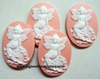 25x18 fairy on rock resin cameos white on pink .. 4 pieces