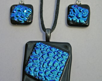 Pebbled teal dichroic glass pendant and earrings set.  Item: T22