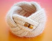 Handmade Baby Alpaca Cuff with brass closures.
