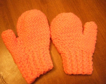 Kids size peach colored mittens.