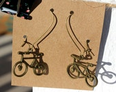 "Bicycle ride, antique gold metal, approx. 2.5"" from top of wire to the drop. Romantic and whimsical"