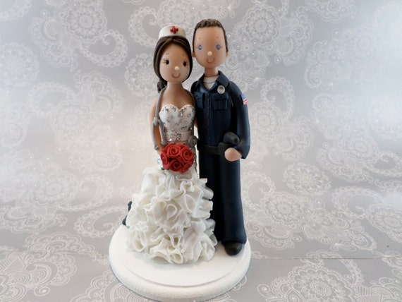 police officer and nurse wedding cake topper officer amp with a cat peaking the dress 18671
