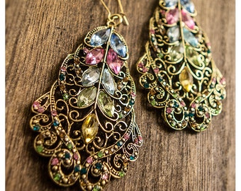 julianka - dramatic earrings of swarovski crystal held captive by filigree of golden brass