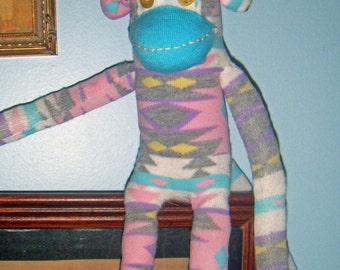Lucy in the sky with yellow button eyes. A lovely pastel sock monkey with a unique pattern.