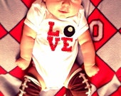 "Buckeye/Ohio LOVE baby Bodysuit, red Love letters with a buckeye as the ""O"""
