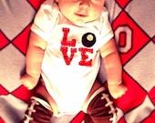 "Buckeye/Ohio LOVE baby Bodysuit, red Love letters with a buckeye as the ""O"""