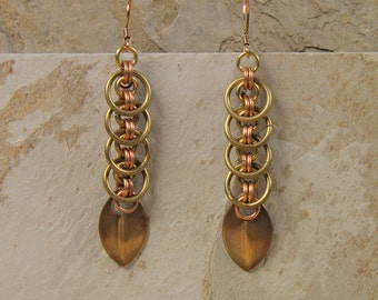 Eclipse bronze earrings, copper and brass rings, bronze scales