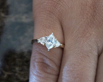 14K Yellow gold diamond marquise engagement ring.
