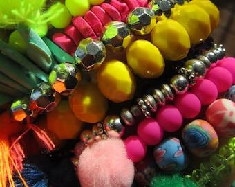 tasseled elastic multi variation beaded bracelets