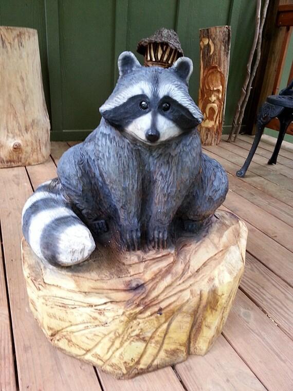 Raccoon wood sculpture