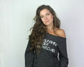 Eco-friendly off the shoulder sweater in Eco-black, Inspirational Ralph Waldo Emerson quote