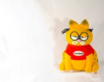 Vintage 80s Talking Grumpy Garfield - eyes roll and says different quotes - pull string - Works!
