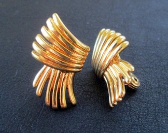 Vintage Monet earrings, gold tone abstract clip on earrings
