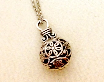 Silver ornate flower ball/purse necklace