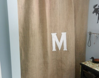 Burlap shower curtain with  boullion fringe and your initial painted in the color of your choice.