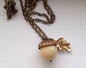 Acorn necklace - Antiqued Brass Acorn and Chain - Gold Colour Leaf - Buttery Cream Czech Faceted Bead