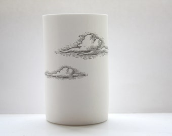 Tall white vase. Up with the clouds - Fine white bone china vase in stoneware with a cloud illustration.